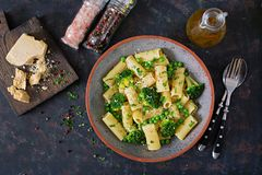 Pasta rigatoni with broccoli and green peas. Vegan menu. Dietary food. Flat lay. Top view Stock Photo