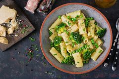 Pasta rigatoni with broccoli and green peas. Vegan menu. Dietary food. Flat lay. Top view Royalty Free Stock Photo