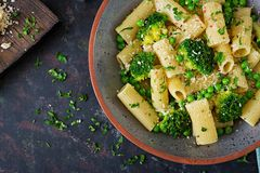 Pasta rigatoni with broccoli and green peas. Vegan menu. Dietary food. Flat lay. Top view Stock Photography