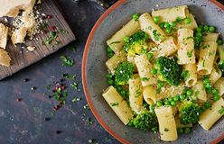 Pasta rigatoni with broccoli and green peas. Vegan menu. Dietary food. Flat lay. Top view Royalty Free Stock Photos