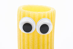 Pasta rigatoni with googly eyes on white background. Pasta face Stock Photography