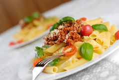 Pasta rigatoni on the white plate Stock Photo