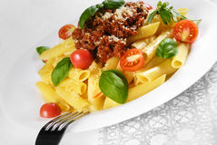 Pasta rigatoni on the white plate Royalty Free Stock Images