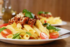 Pasta rigatoni on the white plate Royalty Free Stock Photos