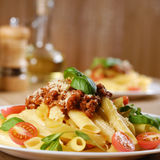 Pasta rigatoni on the white plate. Rigatoni pasta with a tomato beef sauce in the white plate Royalty Free Stock Photos