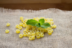 Pasta rings on background Stock Photography