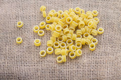Pasta rings on background Royalty Free Stock Images