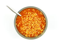 Pasta rings with tomato sauce and spoon in bowl Royalty Free Stock Photo