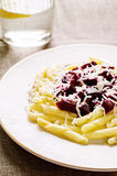 Pasta with roasted beets and goat cheese Royalty Free Stock Photos