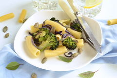 Pasta with roasted broccoli, onions and pumpkin seeds Royalty Free Stock Image