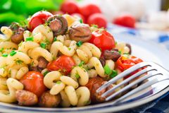 Pasta with roasted mushrooms and cherry tomatoes Royalty Free Stock Photo