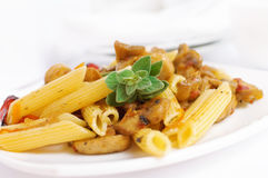 Pasta with roasted pepper and mushrooms Stock Photography