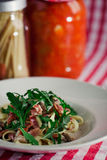 Pasta with rocket salad and ham on the table Stock Photo