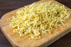 Pasta on a rustic wooden table, homemade egg noodles Stock Images