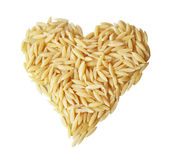 Rice's heart isolated. Heart-shaped pasta rice photographed on a white background. Is the love of Italian cuisine, pasta is a typical dish. Small grains Royalty Free Stock Photo