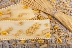 Pasta on sacking close-up macro Stock Image