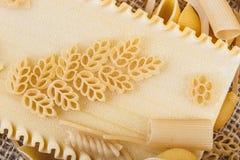 Pasta on sacking close-up macro Royalty Free Stock Image