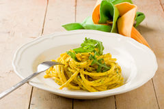 Pasta with Saffron and arugula pesto Stock Image