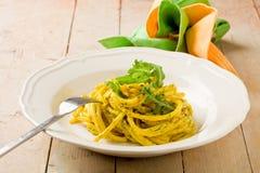 Pasta with Saffron and arugula pesto Stock Image