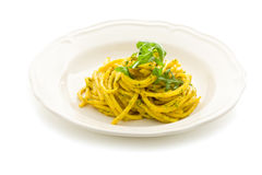 Pasta with Saffron and arugula pesto Isolated Royalty Free Stock Image