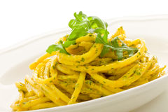 Pasta with Saffron and arugula pesto Isolated Stock Image