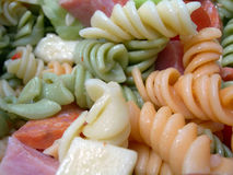 Pasta Salad. Yummy pasta salad with chunks of cheese Stock Photos