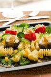 Pasta salad. With tomato,cucumber, corn,goat cheese and pine nut stock photography