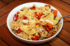 Pasta Salad. With sweet peppers, corn and onions in a white serving bowl stock images