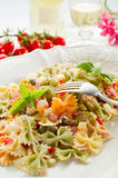 Pasta salad. On dish with fork and white wine royalty free stock image