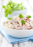 Pasta salad. Fresh pasta salad with tomato royalty free stock photography