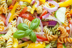 Pasta salad. Macro image of multi-colored pasta salad with vegetables stock photo