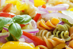 Pasta salad. Macro image of multi-colored pasta salad with vegetables royalty free stock photography