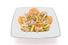 Pasta salad. Special pasta salad made from different vegetables on white background stock photos