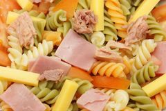 Pasta salad. Close up of a vegetable pasta salad, ham, tuna and cheese stock photos