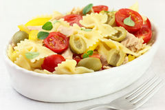 Pasta salad. Italian bow tie pasta salad with tuna, cherry tomatoes, green olives and yellow bell pepper stock photography