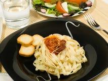 Pasta and salad Royalty Free Stock Photos