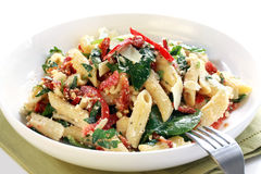 Pasta Salad. With spinach leaves, bell peppers, sundried tomatoes, and parmesan cheese. Healthy fresh eating stock photos