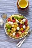 Pasta salad on blue striped tablecloth. Italian Summer easy heal Stock Photo