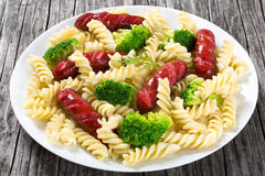 Pasta salad with broccoli and grilled sausages, close-up Stock Photography