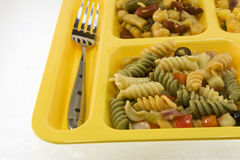 Pasta salad cafeteria tray detail Stock Images