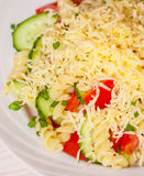 Pasta salad with cheese, tomato and cucumber Royalty Free Stock Photo