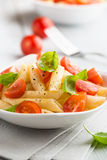 Pasta salad with cherry tomatoes Royalty Free Stock Photo