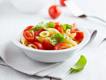 Pasta salad with cherry tomatoes Royalty Free Stock Photos