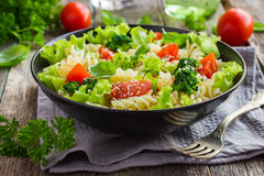 Pasta salad with cherry tomatoes and broccoli stock photo