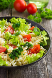 Pasta salad with cherry tomatoes and broccoli stock photos