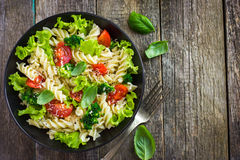 Pasta salad with cherry tomatoes and broccoli royalty free stock image
