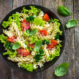 Pasta salad with cherry tomatoes and broccoli Royalty Free Stock Images