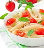 Pasta salad with cherry tomatoes Stock Photo