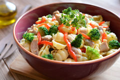 Pasta salad with chicken meat, broccoli, chilli and peppers Stock Photo