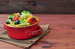 Pasta salad with dried tomatoes, truffle oil and parmesan cheese Royalty Free Stock Image